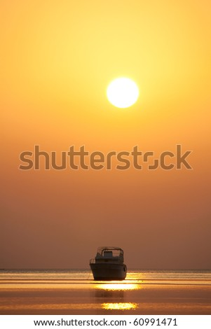 Lonely boat on the background of the sea sunrise - stock photo