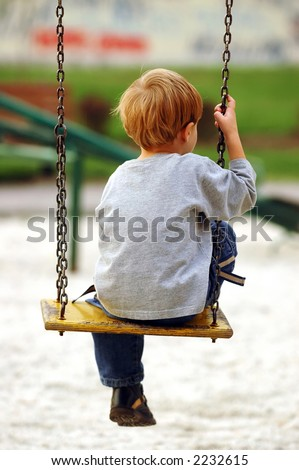 lonely boy in the park - stock photo