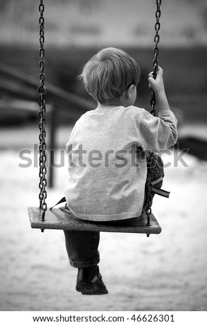 Lonely boy in the park, black and white photo