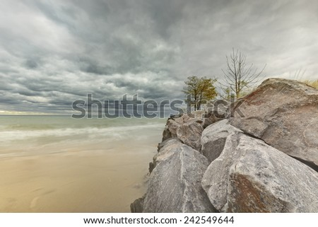 Lonely breakwater on Lake Michigan during colorful Autumn time - stock photo