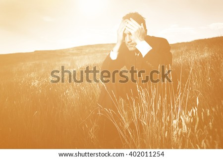 Lonely businessman depressed about life. - stock photo