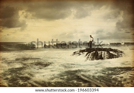 Lonely Businessman Standing by the Seaside - stock photo