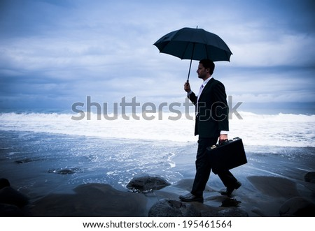 Lonely Businessman Walking by the Beach  - stock photo