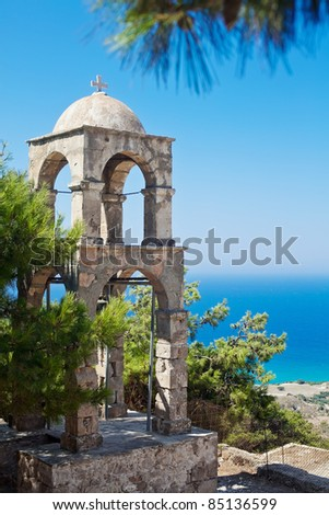 lonely campanile located in the far corner of Kos Island near historic Orthodox church Agios Ioannis - stock photo