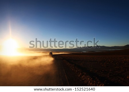 Lonely car at sunrise at Altiplano, Bolivia - stock photo