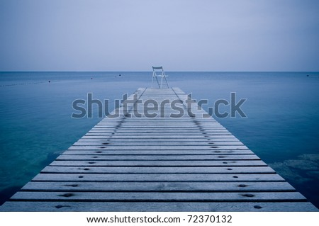 Lonely chair on a wooden pier