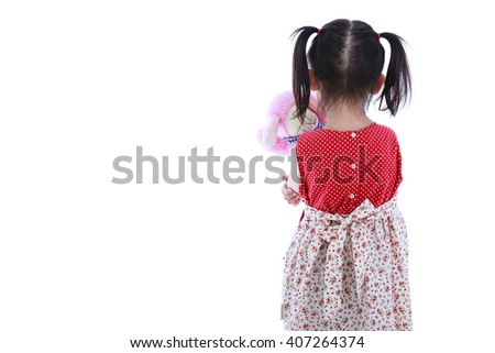 Lonely child with doll sad gesture. Back view. Isolated on white.