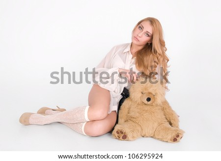 Lonely cute girl sit with lovely teddy bear - stock photo