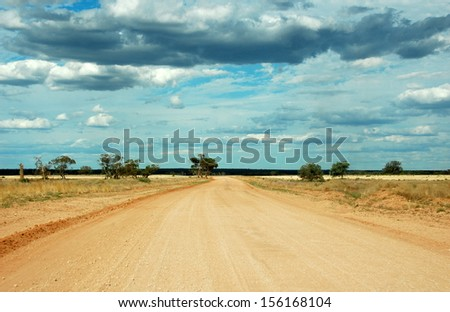 Lonely desert outback road, Australia - stock photo