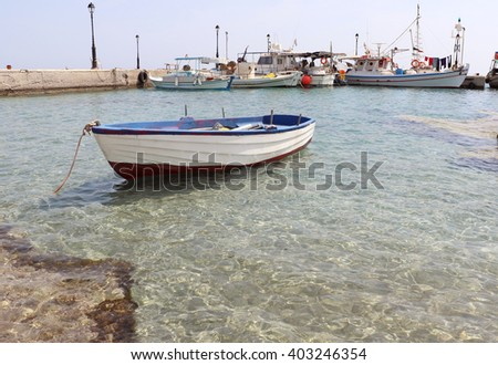Lonely fishing boat. - stock photo