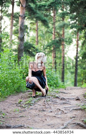 lonely girl in the woods in heels