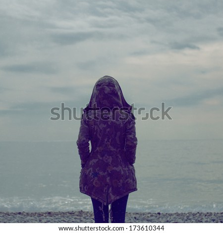 Lonely girl on the shore - stock photo