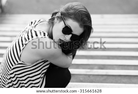 Lonely girl standing on the stairs. Toned image - stock photo