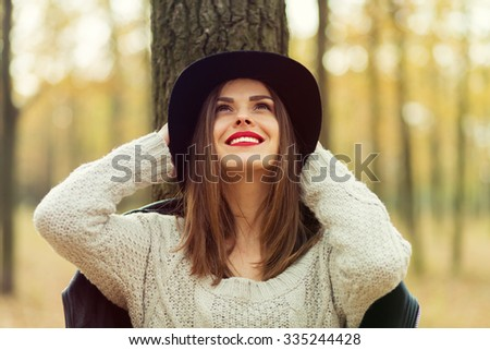 Lonely girl walking in the autumn park - stock photo