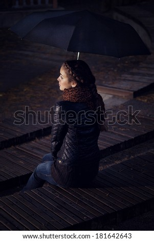 lonely girl with an umbrella in a personal cinema