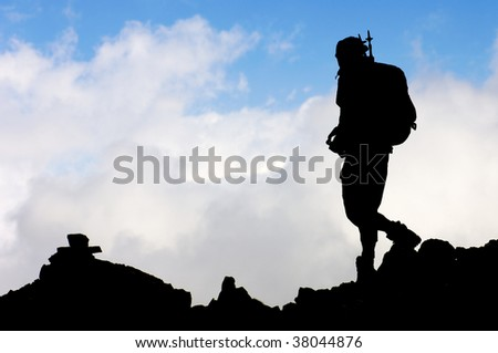 Lonely hiker with blue sky