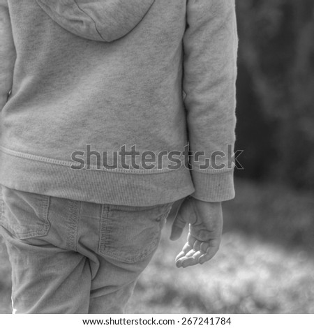 lonely kid, unfocused - stock photo