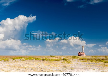Lonely lighthouse at the desertic Klein Curacao island, close to Curacao, Netherland Antilles - stock photo