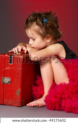 lonely little girl with old suitcase - stock photo