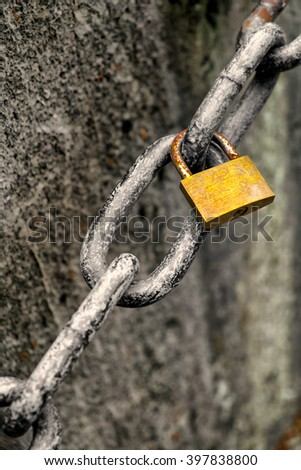lonely love lock is hanging on a chain - stock photo