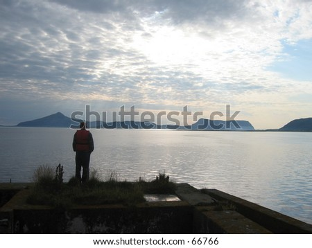 Lonely man exploring the view. - stock photo