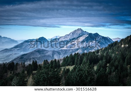 Lonely Mountain. Slovenia beautiful scenic mountain landscape with forest in the foreground. Superb Hiking destination - stock photo