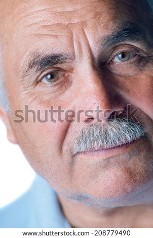 Lonely old man with gray hair and mustache up close on white background - stock photo