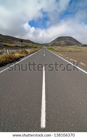 Lonely road in the deseret  on a cloudy sky