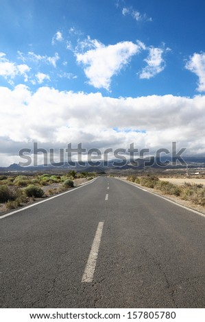 Lonely Road in the Desert in Tenerife Canary Islands - stock photo