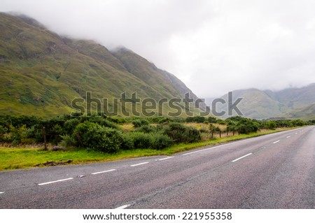 lonely road in the scottish highlands - stock photo