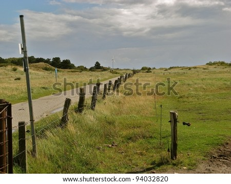 Lonely road towards north end of Spiekeroog island, Germany - stock photo