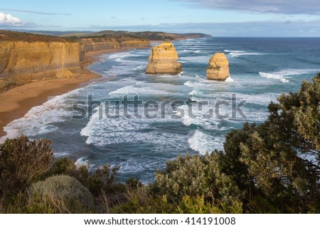 Lonely rocky apostle standing out off mainland at Gibson ladder beach on a sunny summer day. Great Ocean Road - Port Campbell national park in Victoria, Australia - stock photo