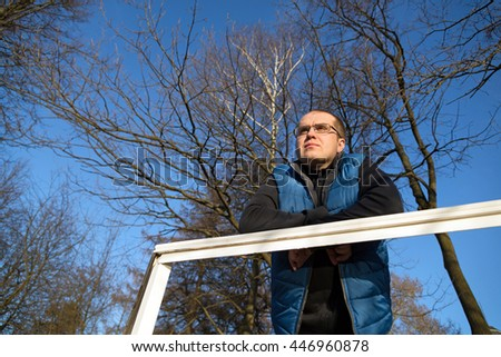 lonely sad man outdoors in autumn forest - stock photo