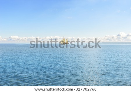Lonely sailboat at sea in clear weather. - stock photo