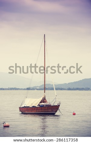 Lonely sailboat on the Constance Lake (Bodensee). - stock photo