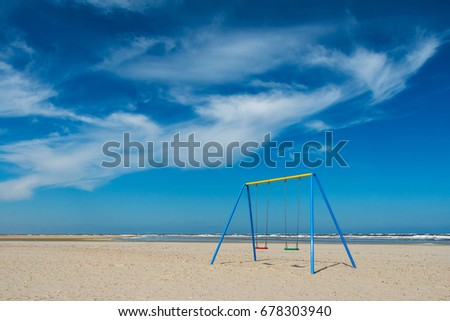 Lonely sand beach with swing, on the German North Sea coast