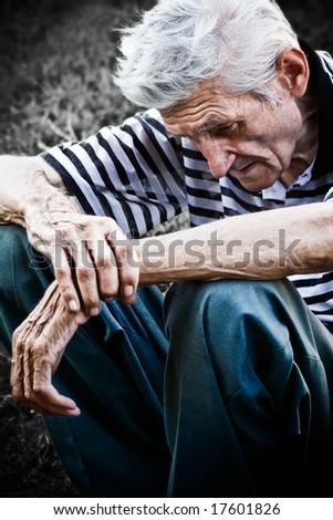 Lonely senior man feeling very sad - stock photo