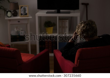 Lonely senior woman being alone at home - stock photo