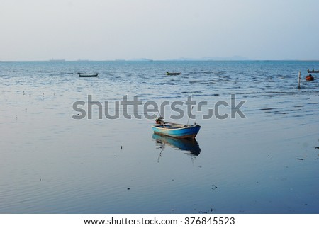 lonely ship floats in the river