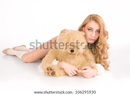 Lonely, tired girl hug the furry bear and relax - stock photo