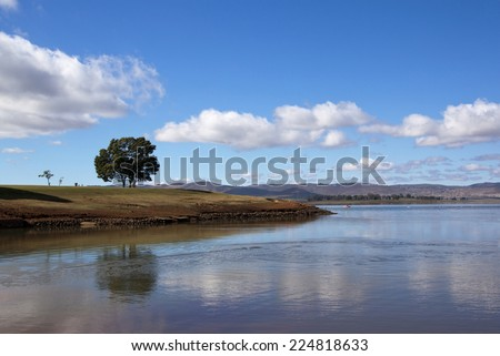 lonely tree reflected in the water of midmar dam