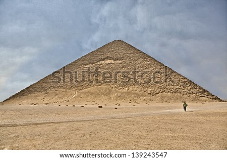 Lonely visitor walking by Red Pyramid of Dahshur, Egypt