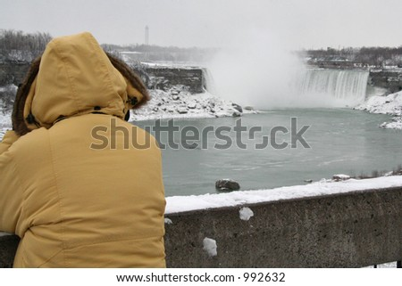 Lonely Woman at the Falls - stock photo