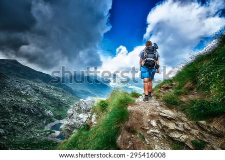 Lonely woman hiker in a mountain path - stock photo