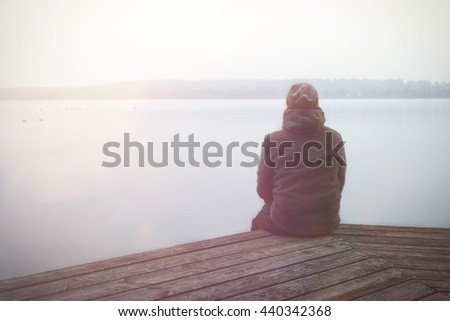 Lonesome Guy At The Lake During Sunrise - stock photo