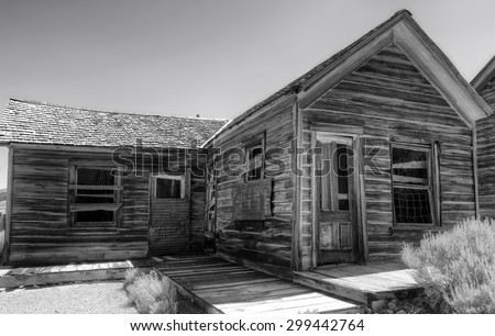 Long abandoned house at California's Bodie State Historic Park, shown in black and white. - stock photo