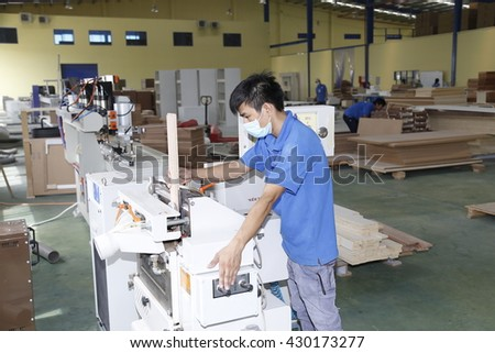 Long An, Vietnam - July 11, 2016: Workers are working in a wood factory for exporting