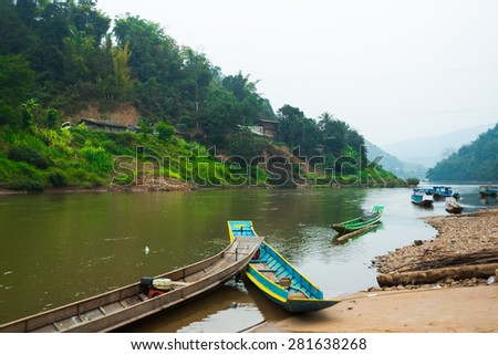 Long and narrow boats on the river in Laos