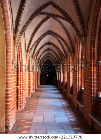 Long arched cloister in the medieval castle - stock photo