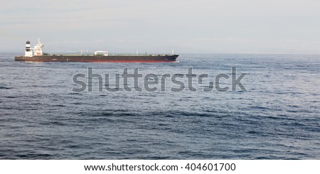 Long background image of a crude oil tanker in the blue ocean. - stock photo